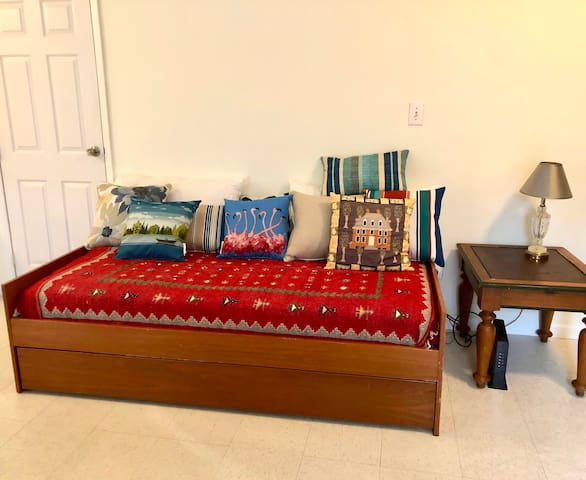 Two single beds (bed & trundle) - located in the living room.