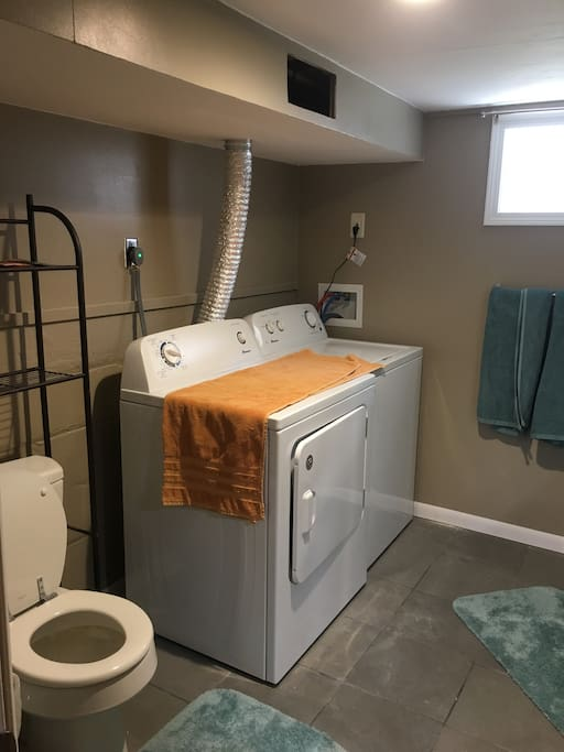 Bathroom is equipped with laundry machines