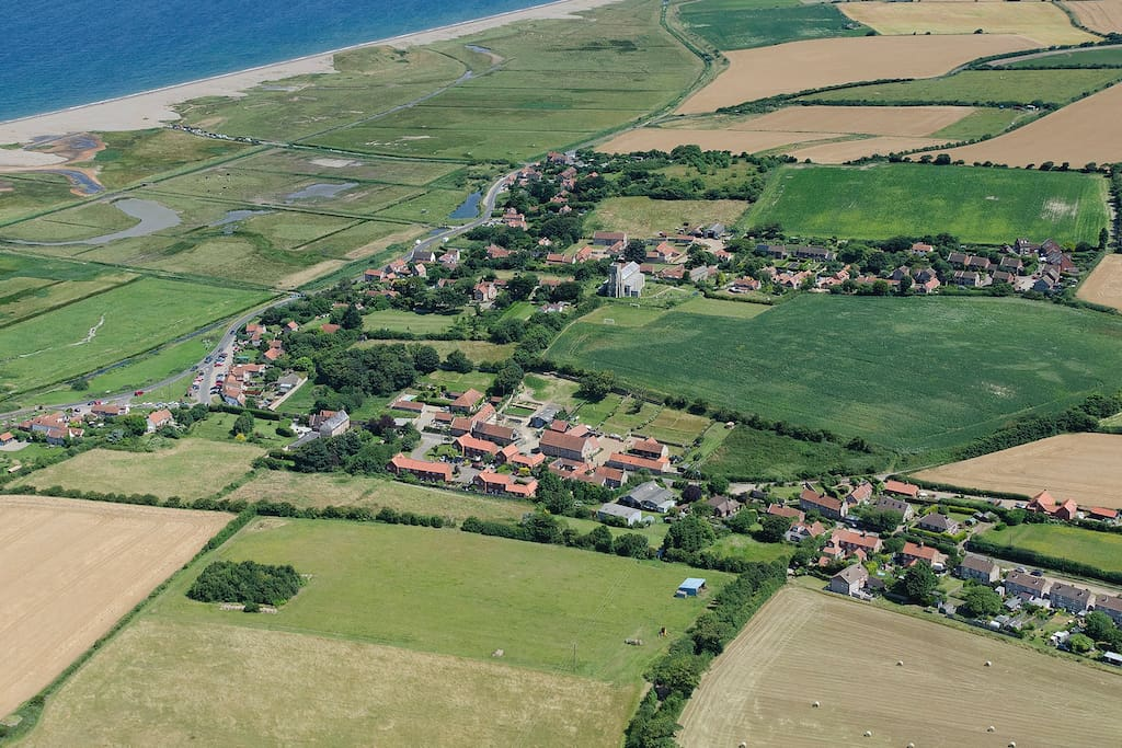 The stunning salt marsh setting of Salthouse, right on the North Norfolk coast AONB.  Aerial shot supplied by kind permission - John Fielding Aerial Images, Copyright 2018