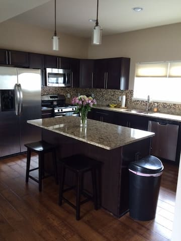Kitchen includes stainless steal appliances, granite, plenty of cabinets for storage, as well as a sizable pantry.