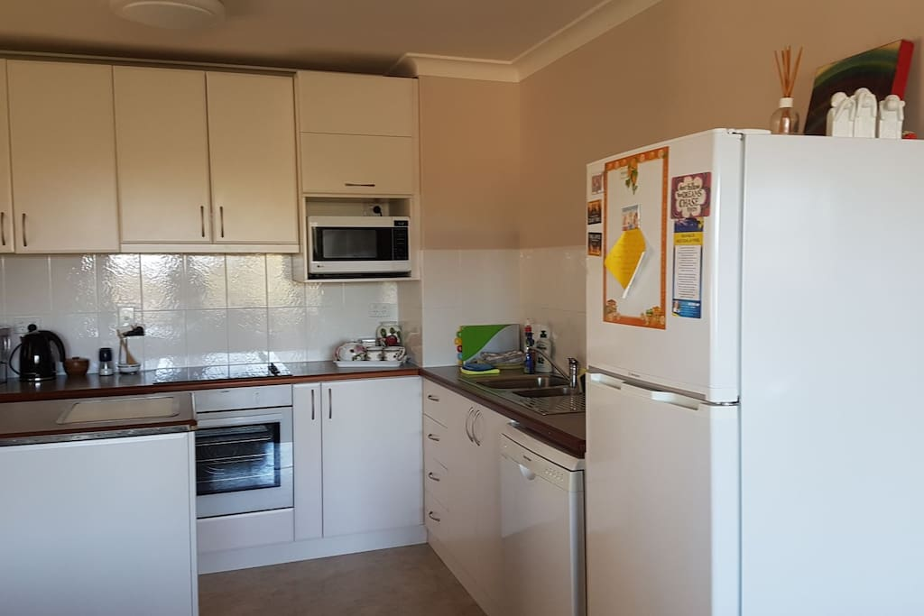 Spacious kitchen.  Electric stove, oven, microwave, fridge, dishwasher. All crockery and cutlery, pots, pans. Aldi coffee maker, plus ( lots of appliances too)