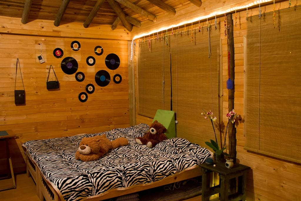 Main room at night - king bed