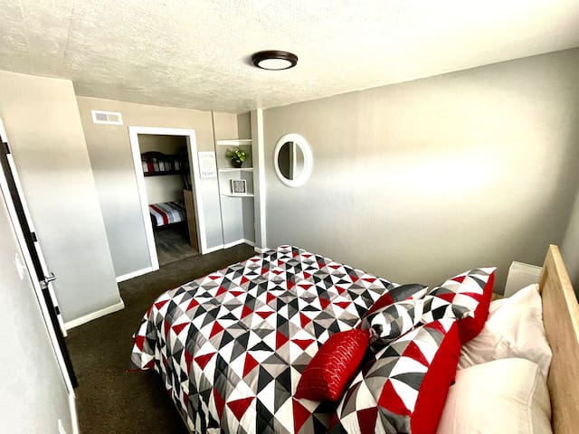 Queen Bed with adjoining full / twin bunk beds.