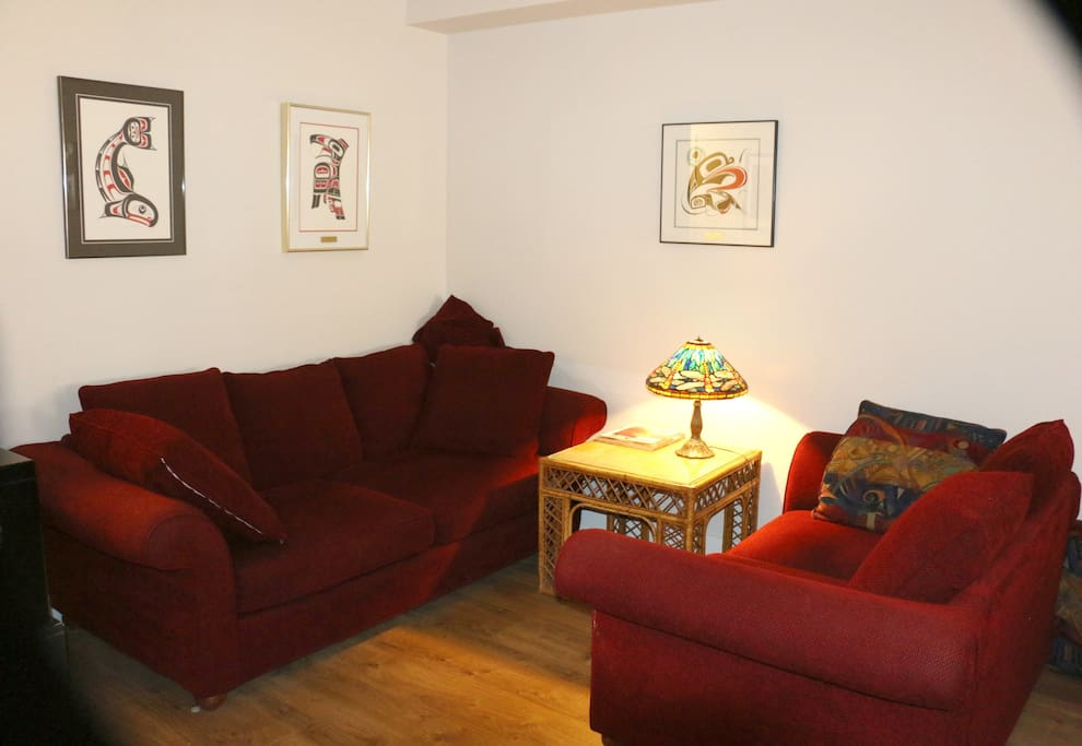 Open, high ceiling living room area; very comfortable couches