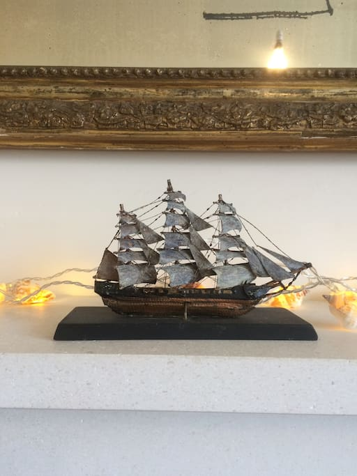 Little ship on the fireplace mantle.
