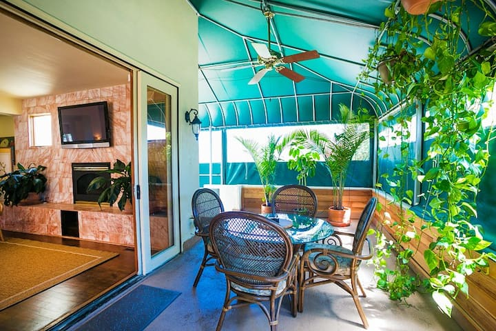 Sun room is  perfect for relaxing with dining space for 4 people.