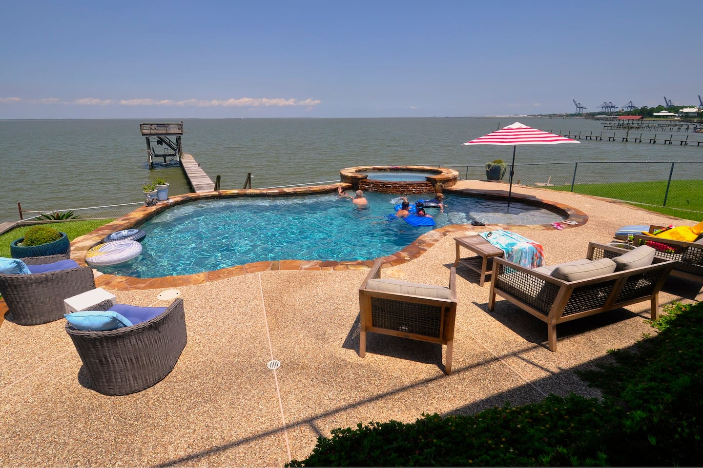 Enjoy this swimming pool with a lovely bay view! Shared only with owners