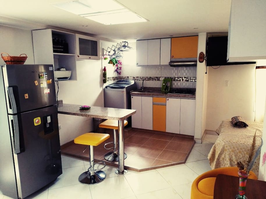 Television with national channels, mini-component, private bathroom, private kitchen with washing machine and fridge