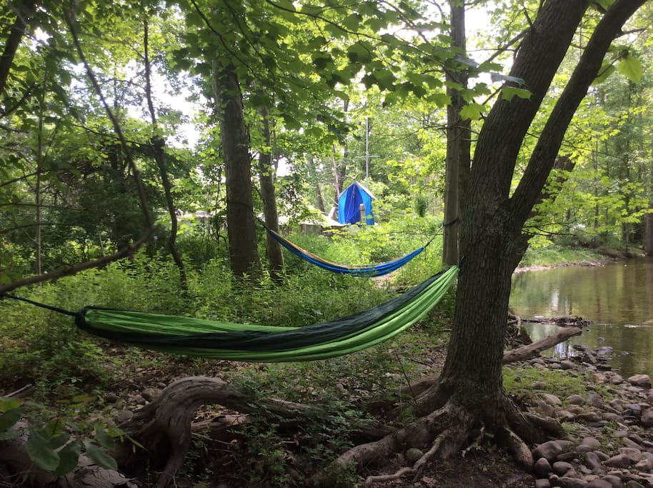 Relax in a hammock by the stream, your camp site is strait ahead.