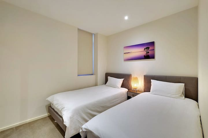 2nd bedroom includes 2 king single beds with high-quality mattresses.