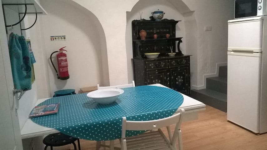Dining room where you can prepare small/light meals. NOT a kitchen.  (With fridge, micro-wave, coffe machine, toaster and Electric kettle).