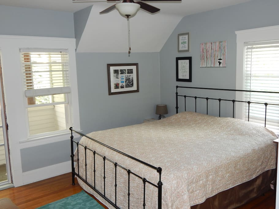 Spacious bedroom including a king sized bed and walkout balcony