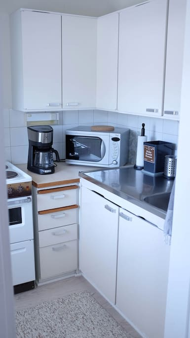 Kitchen with oven, fridge, small freezer and coffeemaker