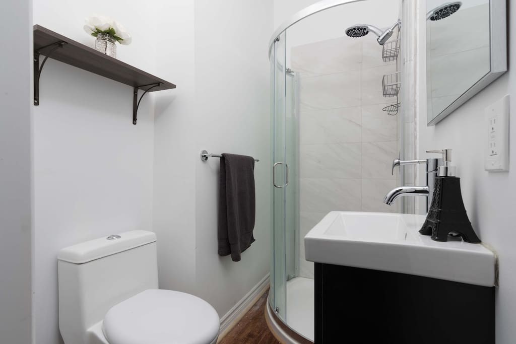 Your newly renovated private ensuite washroom features a powerful rainfall shower head.