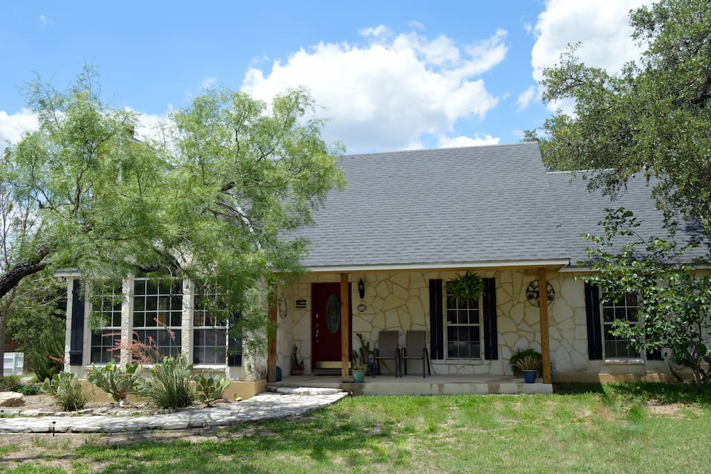 Relax on the front porch or in the large oak covered backyard...