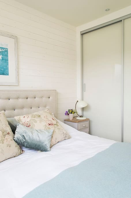 There is a built-in wardrobe in the main bedroom with hanging space and shelves.
