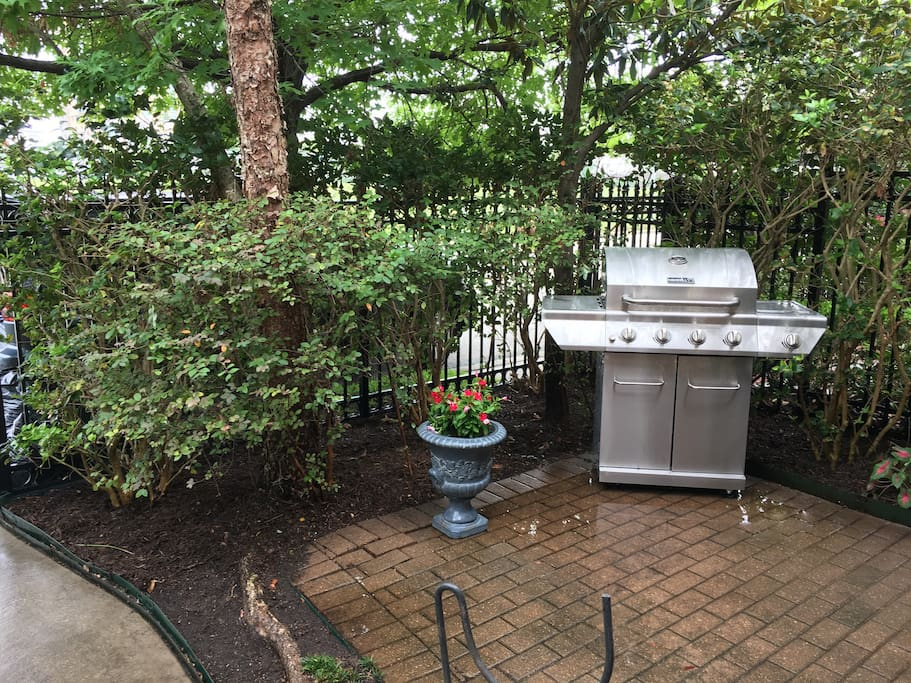 View of patio and gas grill in front courtyard
