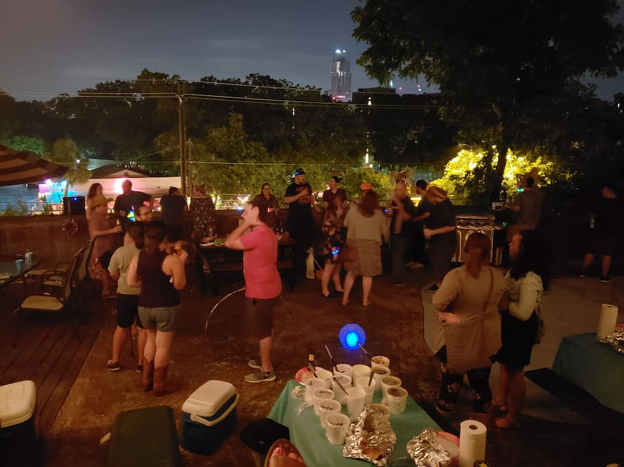 Stay with us and you'll make new friends while staying on every Austinite's favorite street!  A view of one of our social events - downtown Austin in the background, a short walk away!