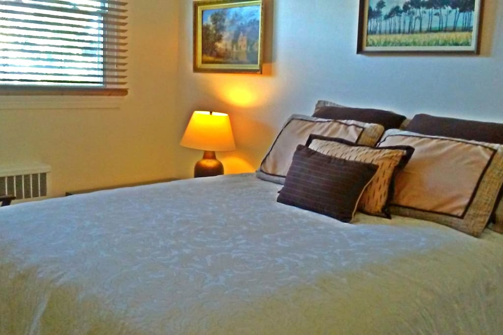 Luxuriate in your queen-sized bed outfitted with all-cotton sheets. Luggage rack and armchair also inhabit the room. Ceiling fan and independently controlled central air/heat provide for personalized comfort.
