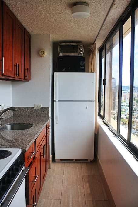 Full kitchen with coffeemaker, fridge, etc.