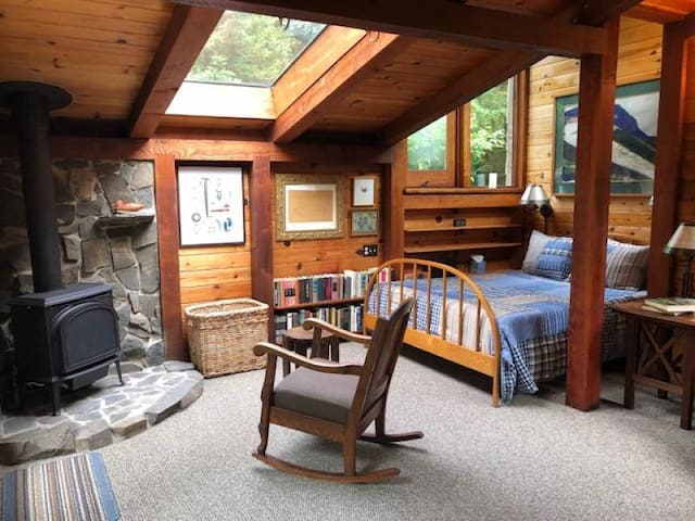 The extra large skylight bathes the bedroom with natural light and adds to the ambiance of the cabin.