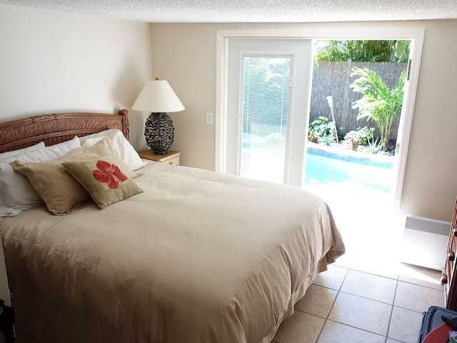 Waterfall Room has a California king bed. Doors open to the pool area. It also has a couch, so a child can sleep with parents in this room if desired