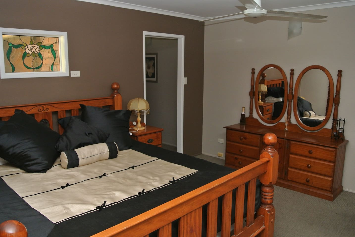 Spacious master bedroom with kingsize bed.