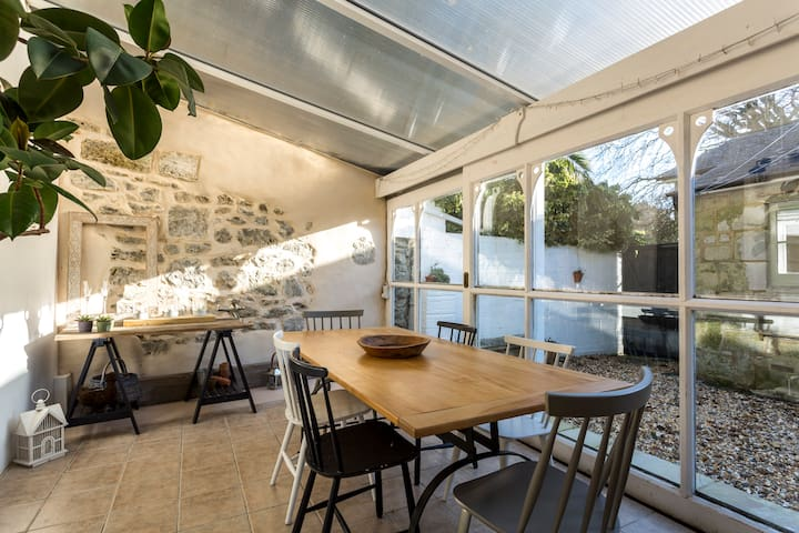 Victorian conservatory opening onto courtyard