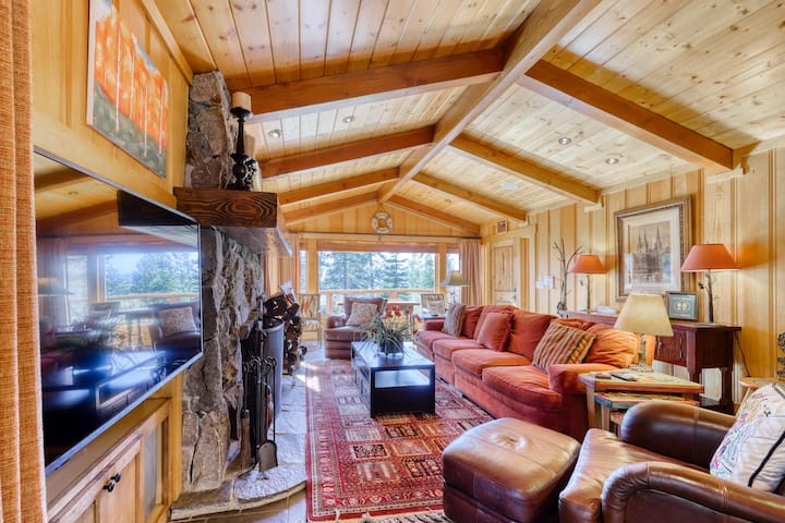 Cozy up by the fireplace with your dog at this lakeview home