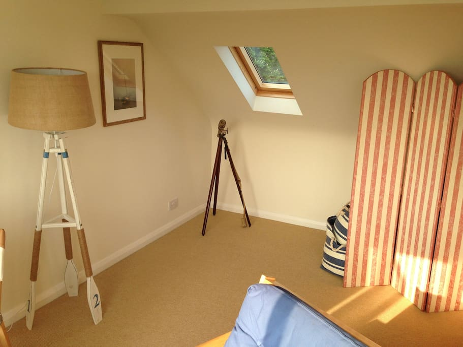 Top room has a sofabed and two single beds (hidden behind the screen).. and a telescope.