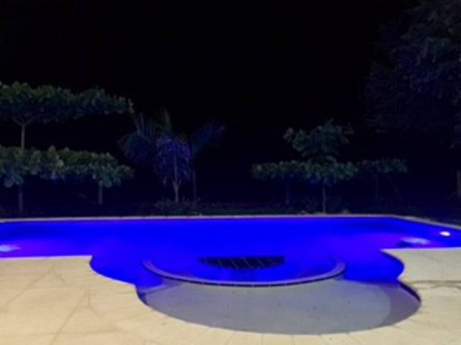 The pool lights create a great effect at night.
