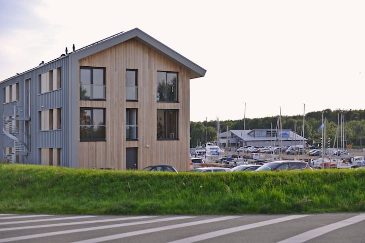 Acogedor apartamento tipo loft en Kamperland con terraza privada