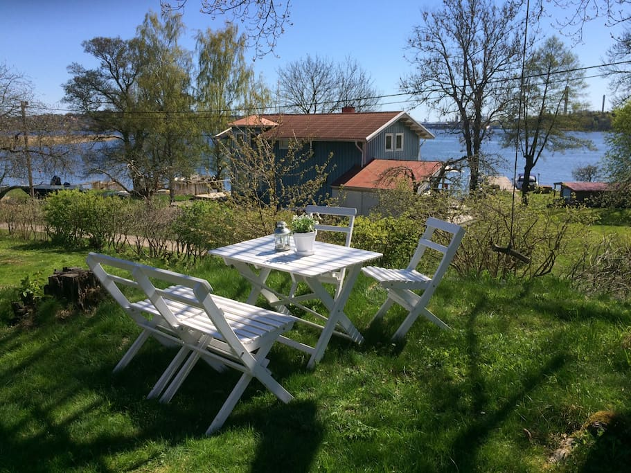 Your own front yard and sitting group  with sea view and view of the Lidingö bridge in the background (quite spectacular in the evenings).
