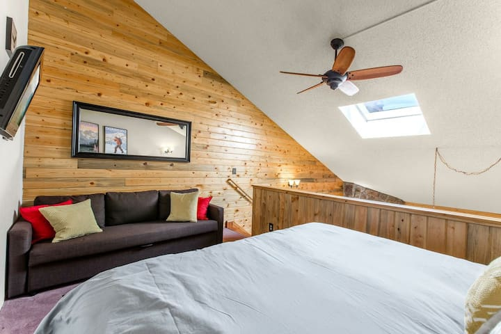 King-size bed and full-size sofa sleeper in loft area.  Ceiling fan.  The sky light adds plenty of natural light to your stay.