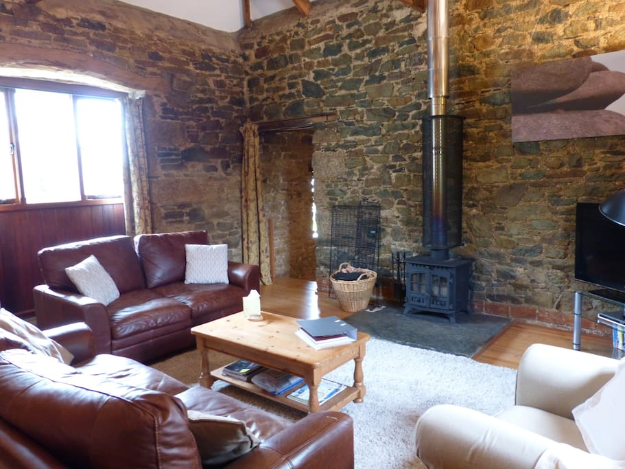 Large living area with cosy wood burning stove