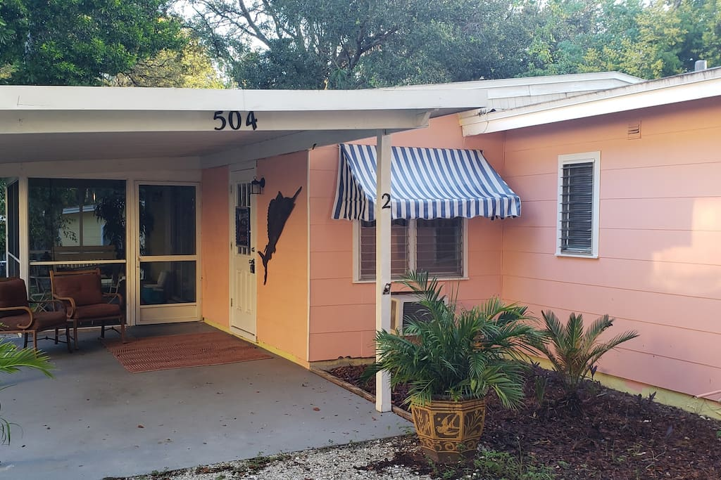 Apartment private entrance under carport with attached screened porch with swing