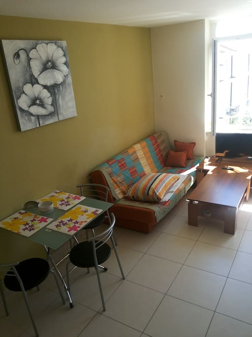Main room, living and dining room, bedroom, folding couch and kitchen table