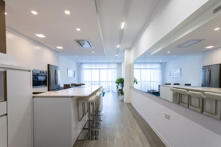 A large bright kitchen and living room leading to the terrace overlooking the famous seafront pools.