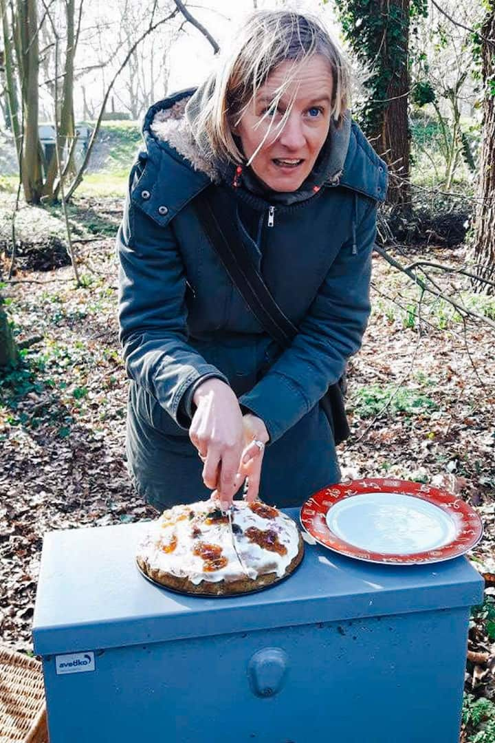 Me cutting a nettle cake for my guests