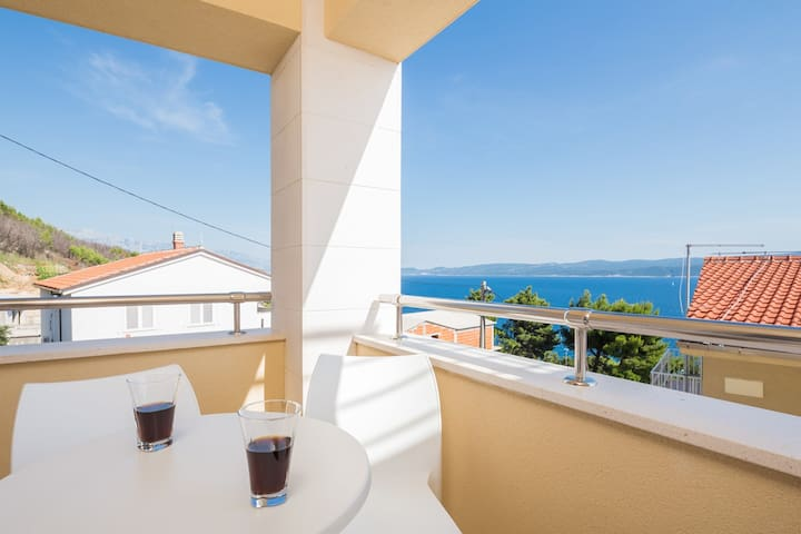 Apartment 1 Loggia with outdoor seating with views to  the Adriatic Sea