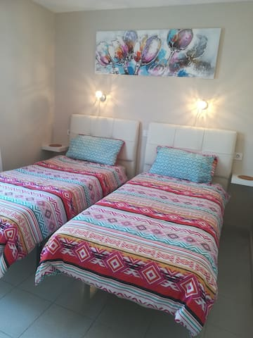 Twin bedded with super comfortable beds.  There is a modern wardrobe with plenty of hanging space, shelves and full size mirror.