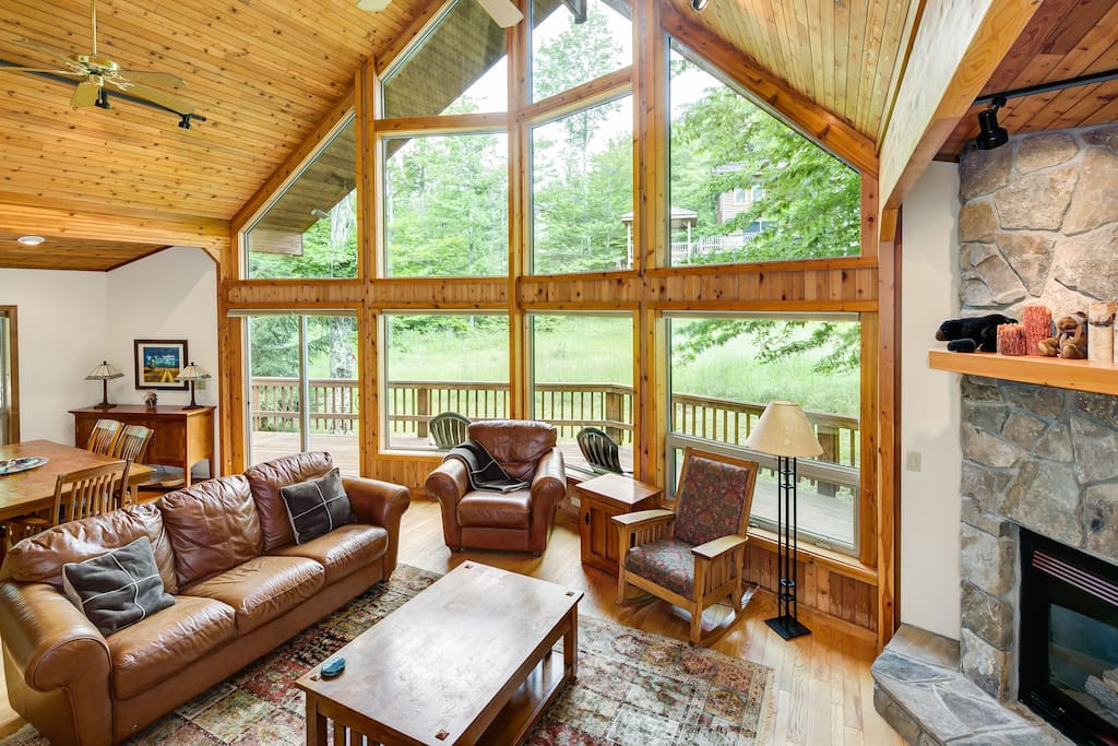 Great room with a wall of windows facing the Winterset ski run.