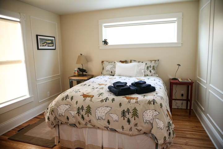 Guest bedroom perfectly appointed with a queen bed and flannel sheets during snowy winter nights.