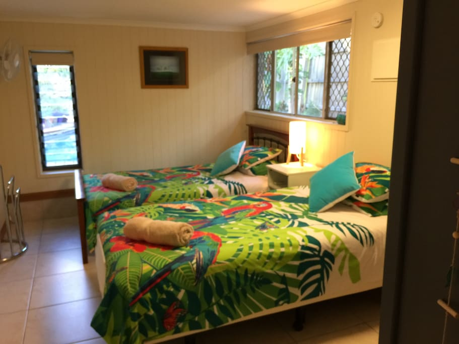 2nd bedroom: 'tropical' theme. Two king single beds. Next door to 1st bedroom.