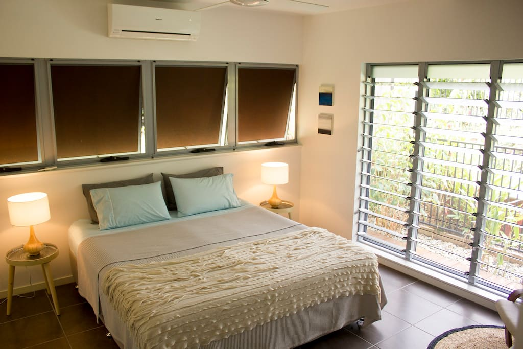 Spacious bedroom with king bed, garden views and walk-in robe