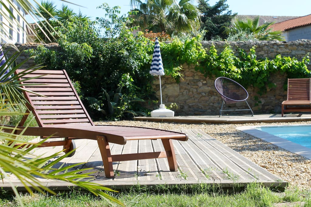 Lovely sunny  pool with loungers