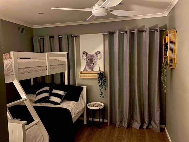 """Cosy and quiet 2nd bedroom with 40"""" Smart TV  I x Double bunk 1 x Single bunk  1 x Single trundle bed Equipped with ceiling fan and oil radiator heater for the winter months. Built in wardrobe with storage Chest of drawers"""