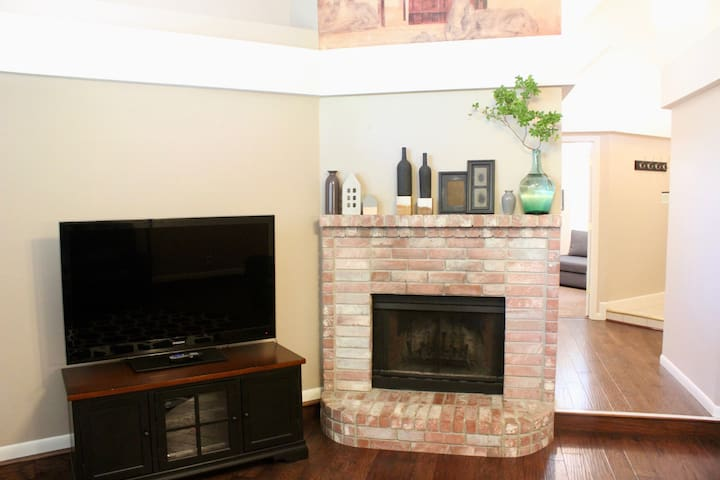 Cable tv and fireplace in living room.