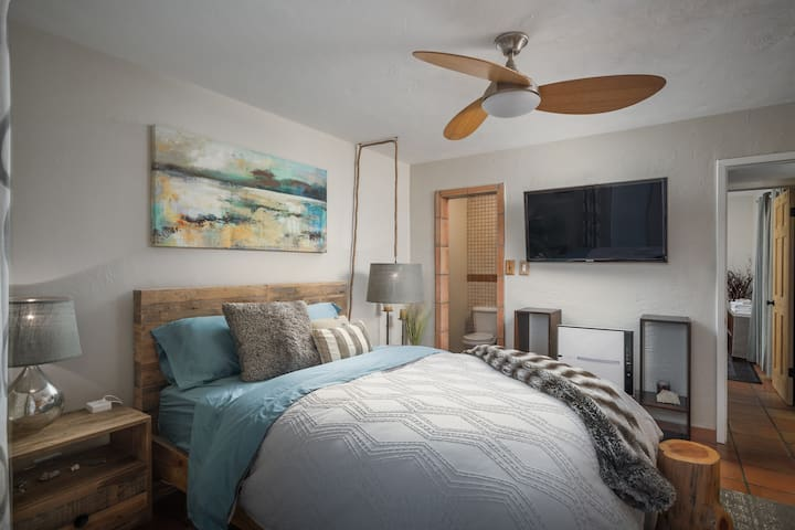 """Second master bedroom has its own full bathroom, 43"""" TV, 9 foot long built-in closet ready with hangers and ceiling fan with remote."""