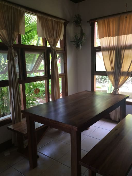 Beautiful new dining table with garden views